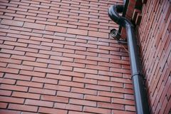 Security camera on red brick wall Stock Photo