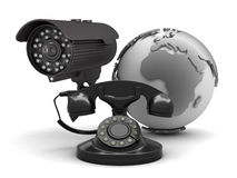 Security camera and retro rotary phone Royalty Free Stock Images