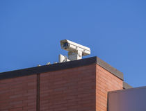 Security camera on roof. Of commercial building Stock Photography