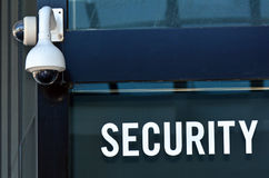 Security Camera and sign. On a building wall. Concept photo security ,protection,surveillance Stock Photos