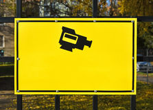 Security camera sign on the fence Royalty Free Stock Photography