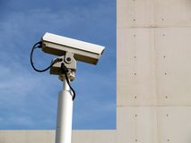 Security camera and sky. Security camera against a blue sky Royalty Free Stock Images
