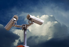 Security camera on the sky. Security camera on the blue sky Stock Photo