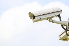 Security camera on sky background Stock Photo