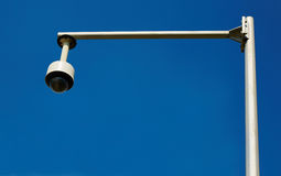 Security camera. Electronic cctv security camera, surveillance camera on blue sky background Royalty Free Stock Images