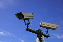 Security camera and urban video. Against blue sky royalty free stock photography