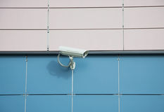 Security camera on a wall Stock Images