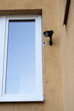 Security camera. On the wall Royalty Free Stock Photo