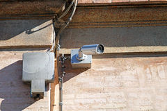 Security camera. On the wall royalty free stock images