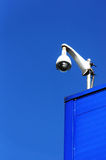 Security camera on wall against blue sky Stock Photography