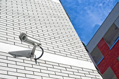 Security camera on the wall as Private property pr. CCTV camera. Security camera on the wall as Private property protection concept Royalty Free Stock Photography