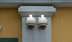 Security camera on wall building Royalty Free Stock Photos
