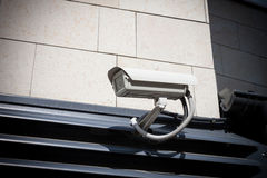 Security camera on the wall Royalty Free Stock Image