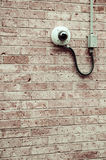 Security camera on the wall Royalty Free Stock Photo