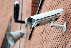 Security camera on the wall Stock Images