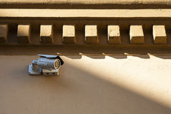 Security camera on a wall. Stock Images