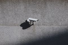 Security camera on the wall stock photography