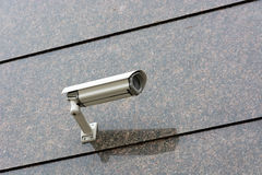 Security camera on the wall. Stock Photos