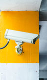 Security camera on the wall Stock Photo