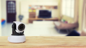 Security camera on Wood table. IP Camera royalty free stock image