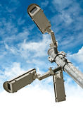 Security Cameras on Blue Sky Background Stock Image