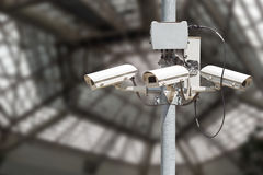 Security cameras with blurry modern building background Stock Image