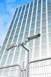 Security cameras building Royalty Free Stock Image