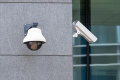 Suveillance cameras on facade stock images