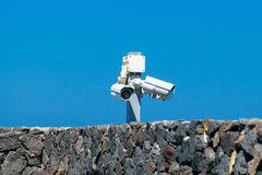 Security cameras over a stone. stock photography
