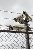 Cameras on top of security fence Royalty Free Stock Photos