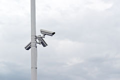 Security cameras on the post Royalty Free Stock Images