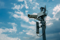 Security Cameras. With Sky Background Stock Photo