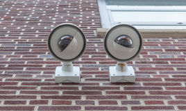 Security cameras, Two CCTV on the brick wall Royalty Free Stock Photos