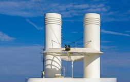 Security Cameras by White Smokestacks Stock Photo