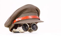 Security. Cap with binocular on a white background Royalty Free Stock Images