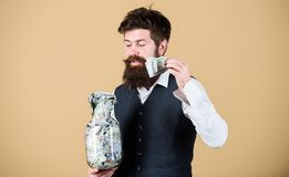 Security and cash money savings. Man bearded guy hold jar full of cash savings. Start saving for your retirement as. Early as possible. Establish your budget stock photography