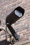 Security cctc cameras mounted on red brick wall. Royalty Free Stock Photos