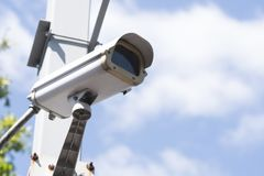 Security CCTV camera in garden. On blue sky background Royalty Free Stock Photo
