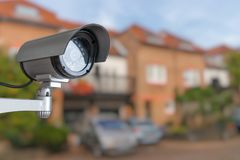 Security CCTV camera is monitoring home. Surveillance and safety concept.  royalty free stock image