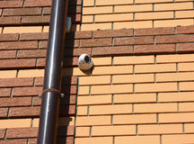 Security  CCTV camera is mounted on a wall. Stock Photos