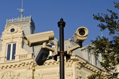 Security CCTV camera on street lamp. In the city center Stock Photos