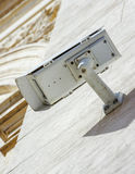 Security CCTV camera or surveillance system fixed on old constru Royalty Free Stock Images
