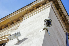 Security CCTV camera or surveillance system fixed on old constru. Ction wall stock images