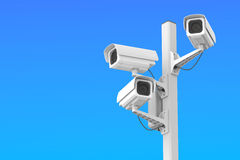Security cctv cameras on blue sky Stock Photo