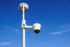 Security cctv cameras on a pole with blue sky background.  Royalty Free Stock Photos