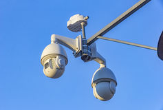 Security cctv cameras. On pylon in blue background Stock Photo