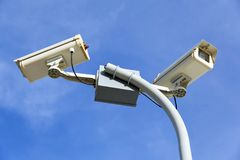 Security cctv cameras. In front of blue sky Royalty Free Stock Images