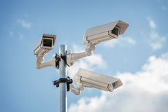 Security cctv surveillance camera. In front of blue sky concept for counter-terrorism, antiterrorism and protection from crime Royalty Free Stock Images