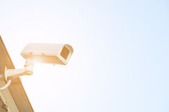 Security cctv surveillance camera in front of blue sky with copy Royalty Free Stock Photography