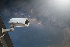 Security cctv surveillance camera in front of blue sky with copy Stock Photo